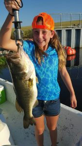 Daughter with 6 lb bass.